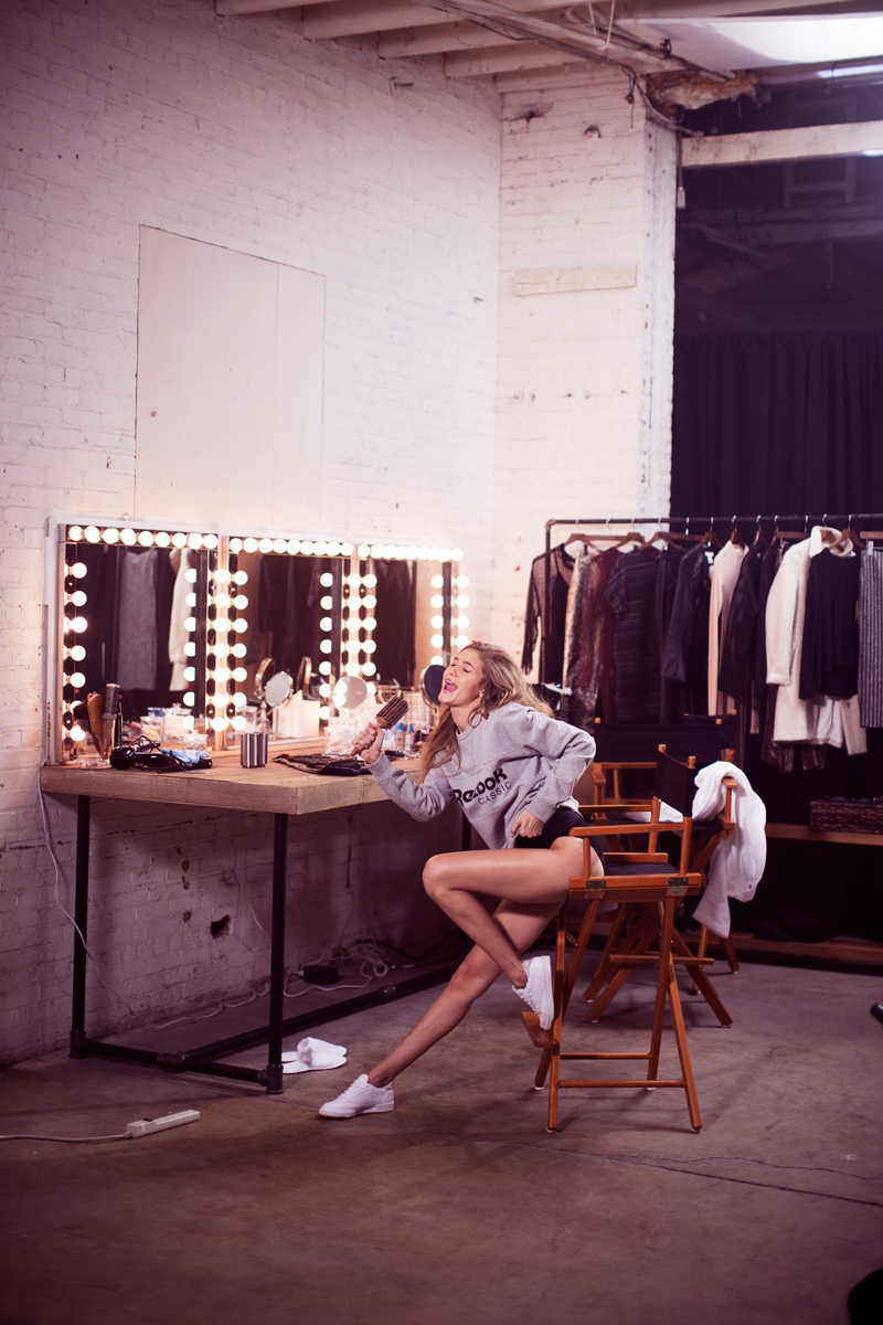 Singing into a hairbrush, Gigi Hadid shows off her playful side for Reebok