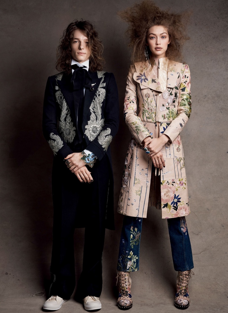 Posing with Mike Faist, Gigi Hadid wears Alexander McQueen leather coat and embroidered jeans