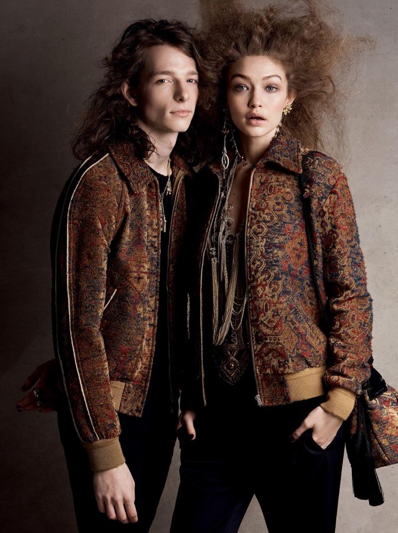 Gigi Hadid models Saint Laurent jacket, blouse, jeans and bag