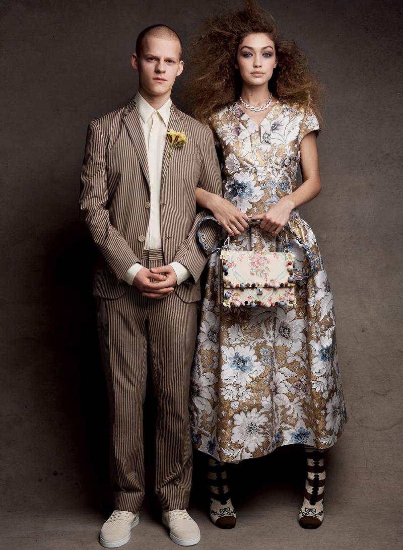 Posing with Lucas Hedges, Gigi Hadid models Fendi brocade dress, bag and boots