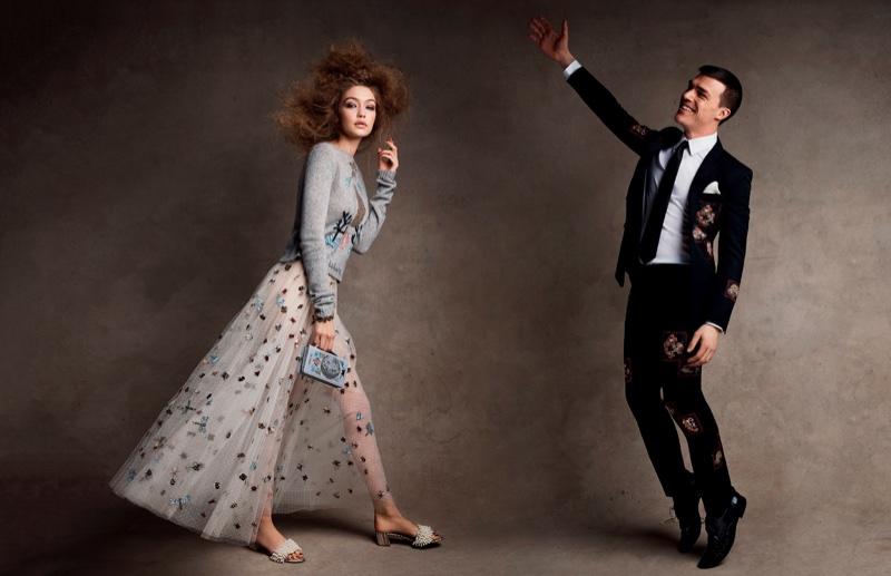 Alongside Finn Wittrock, Gigi Hadid models Dior sweater, skirt and clutch with Tory Burch sandals