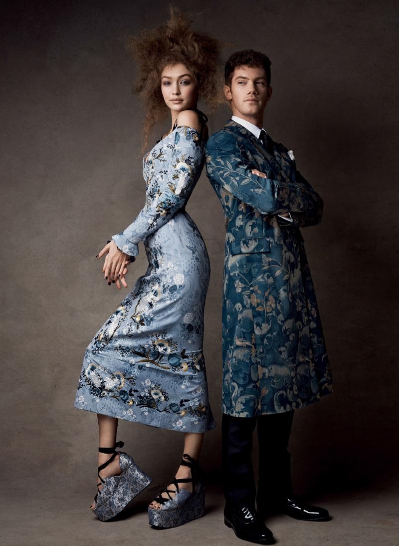 Dressed in an Erdem dress and platform sandals, Gigi Hadid models alongside Alistair Brammer