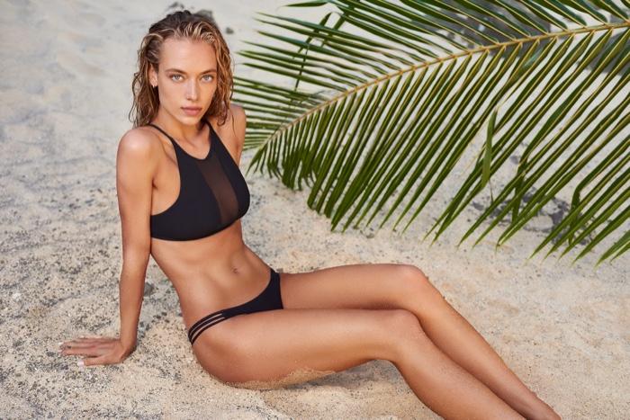 American beauty Hannah Ferguson poses on the beach in KikiRio black swimsuit