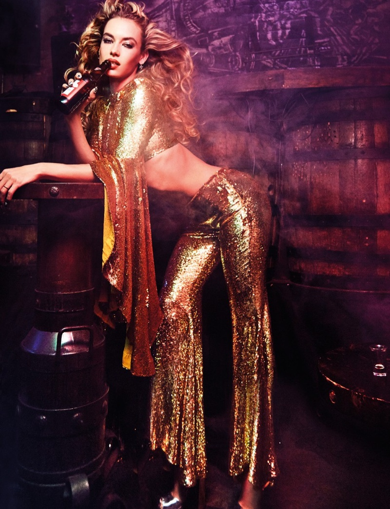 Flaunting her toned midsection, Hannah Ferguson wears gold sequin crop top and pants