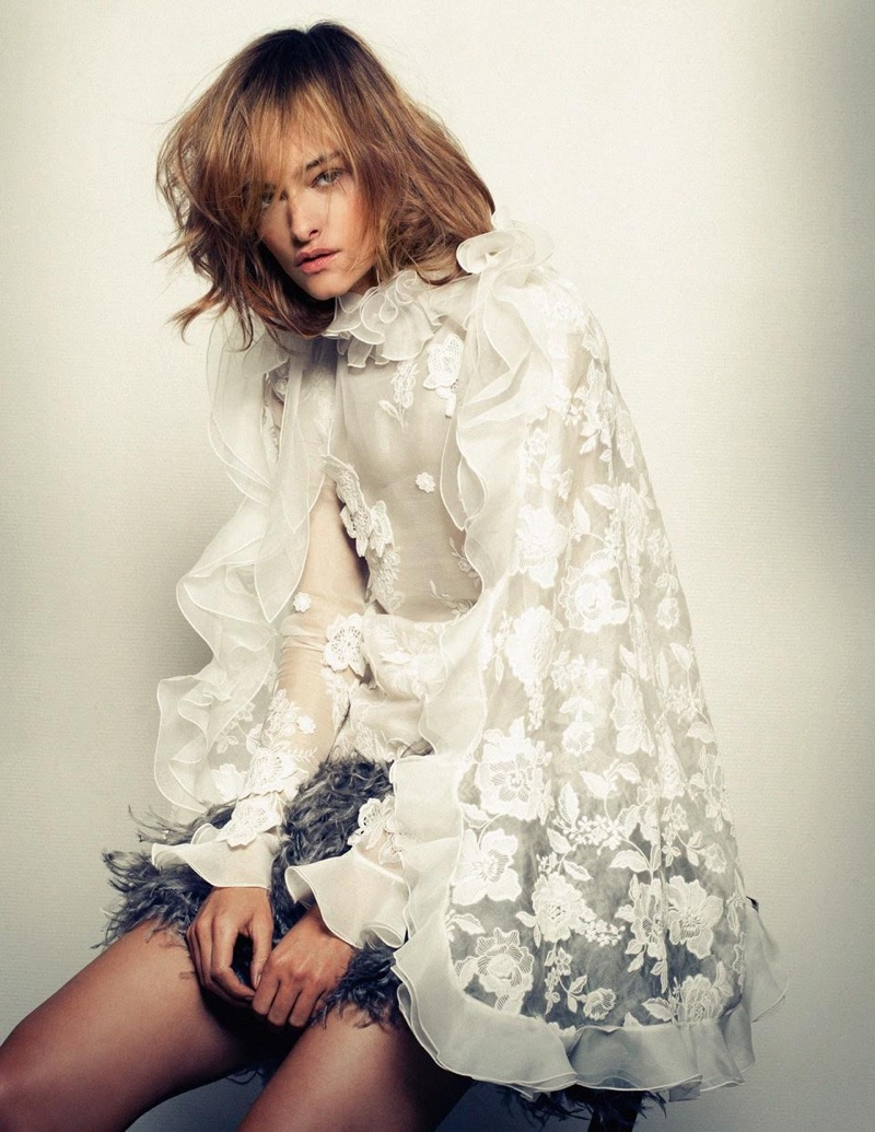 Nadine Strittmatter wears Giambattista Valli Haute Couture lace blouse, cape and skirt with marabou feathers