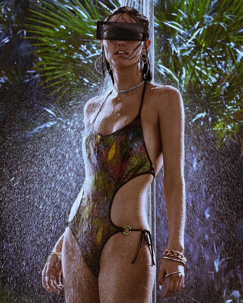The monokini takes the spotlight with Agent Provocateur swimsuit, Maison Margiela sunglasses and Alexander Wang earrings
