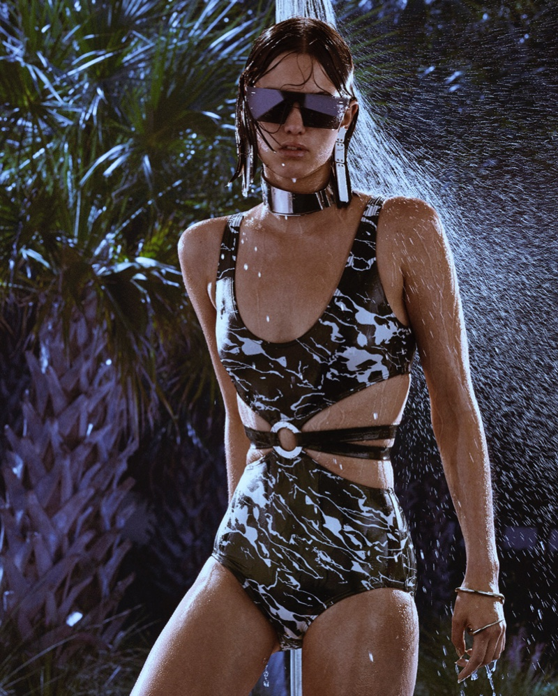 Embracing print, model wears Proenza Schouler swimsuit and earrings. Sunglasses by Koche and necklace by Courrèges.