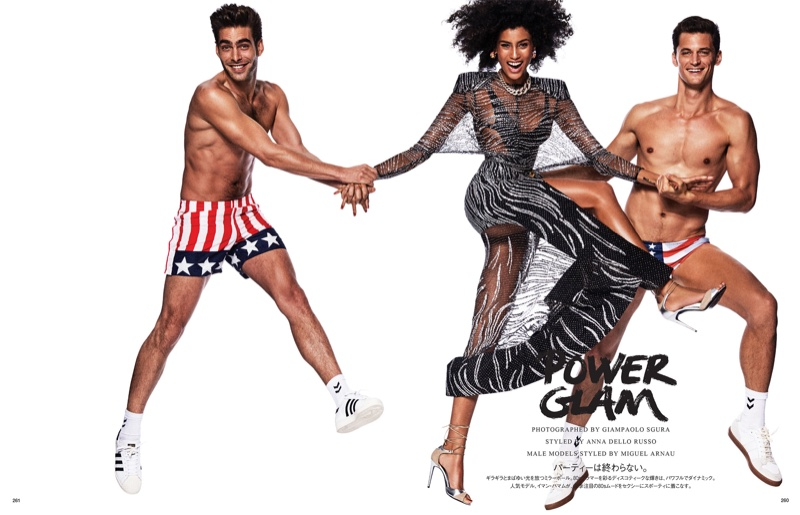 Imaan Hammam poses with male models Jon Kortajarena and Garrett Neff
