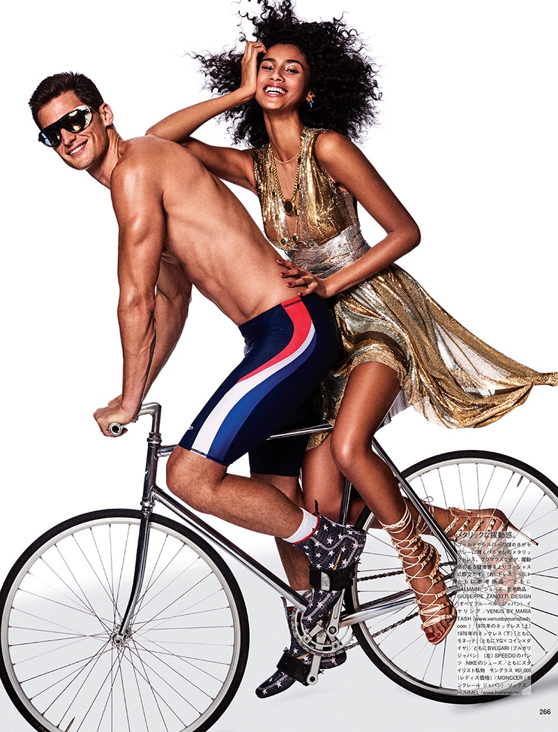 Posing on the back of a bike, Imaan Hammam models gold Balmain dress