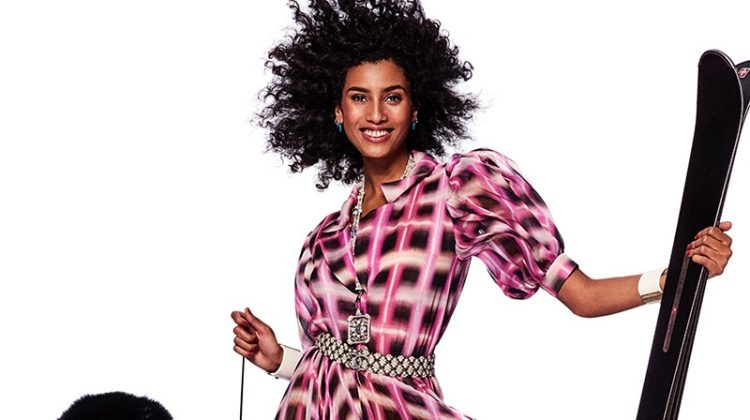 Modeling with skis, Imaan Hammam wears Chanel dress and Paul Andrew sandals