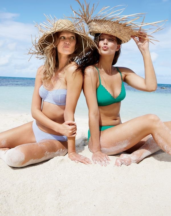 Toni wears J. Crew Underwire Bikini Top ($58) and Bikini Bottom in Seersucker ($44). Emily wears Scalloped French Bikini Top ($68) and Scalloped Bikini Bottom in Italian Matte ($54)