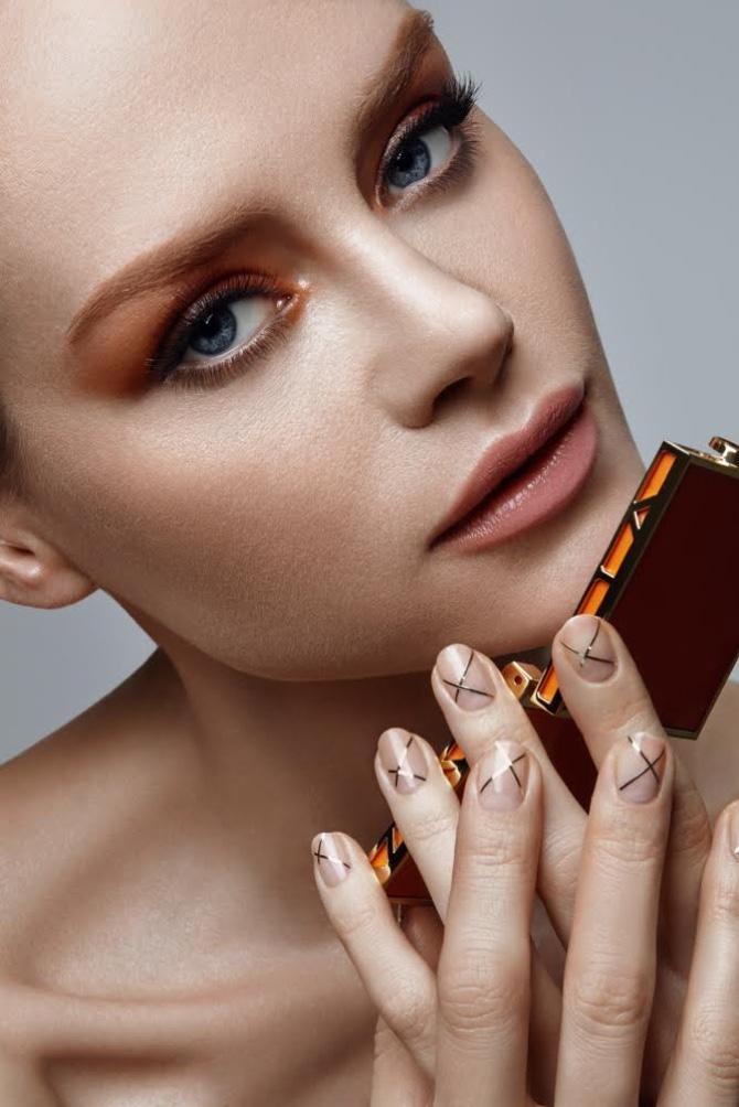 Model Mila Filatova wears manicure with crisscross detail
