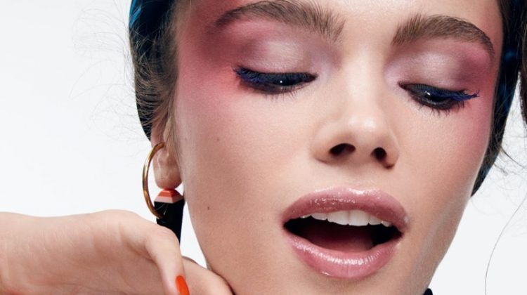 Looking pretty in pink, Jena Goldsack models multi-colored eyeshadow with glossy lip color