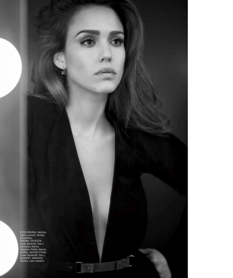 Looking in the mirror, Jessica Alba poses in Saint Laurent dress