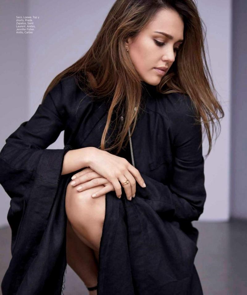 Jessica Alba poses in Loewe coat with Prada top and shorts