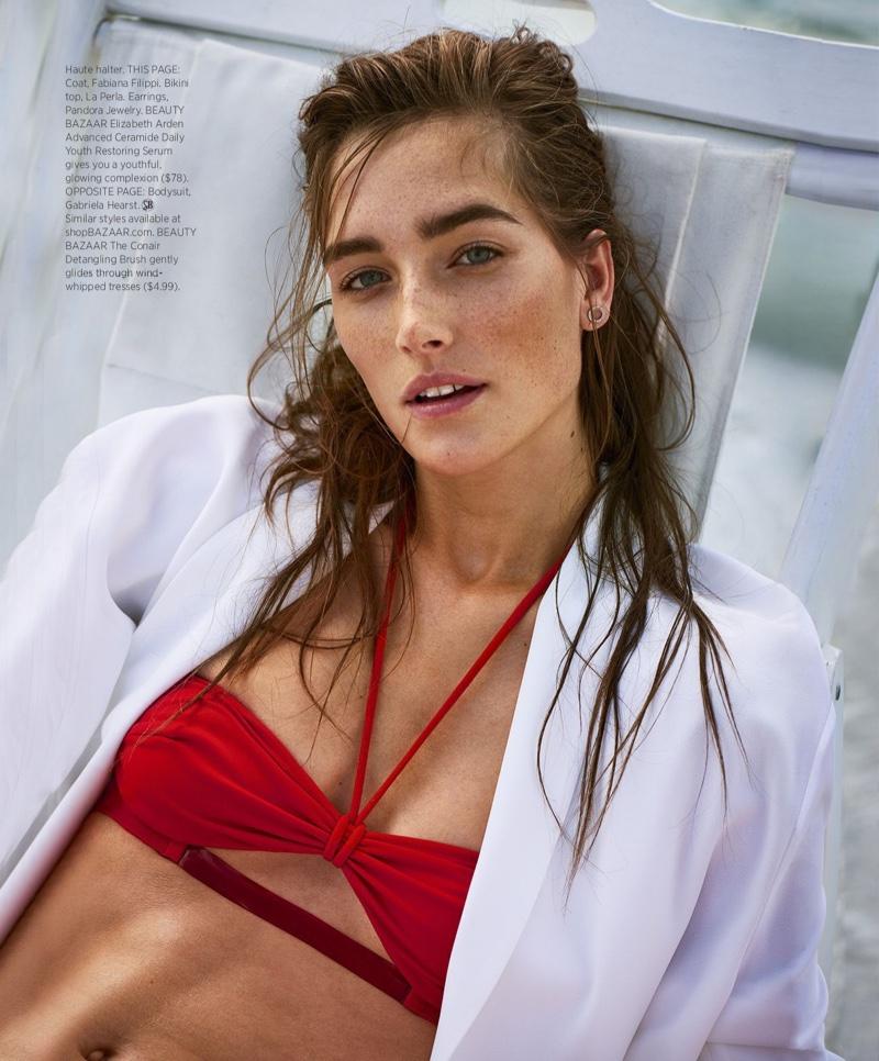 Josephine le Tutour models Fabiana Filippi coat, La Perla bikini top and Pandora Jewelry earrings