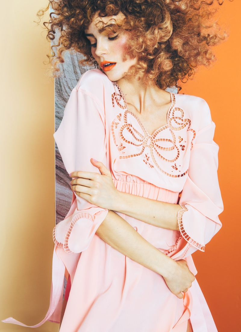Photographed by Christian Oita, the model wears pink crepe de chine dress from Fendi