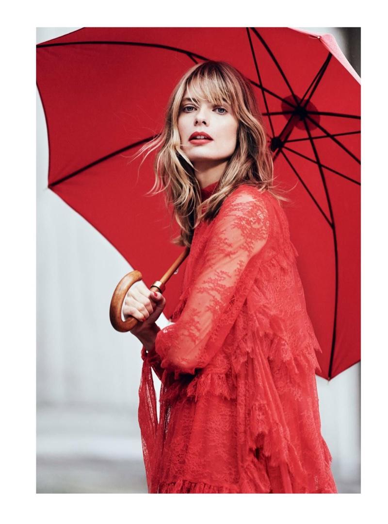 Julia Stegner models Erdem lace dress with James Smith & Sons umbrella
