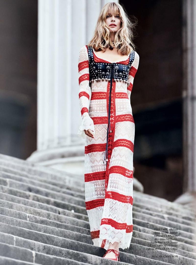 Taking a walk, Julia Stegner models Alexander McQueen silk knit dress and leather harness