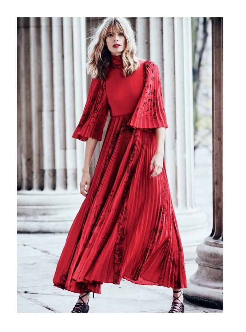 Model Julia Stegner wears Valentino silk dress and strappy heels