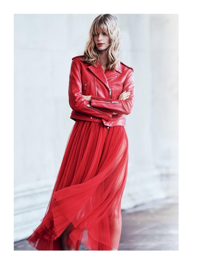 Standing out in red, Julia Stegner poses in Dior leather jacket and tulle dress