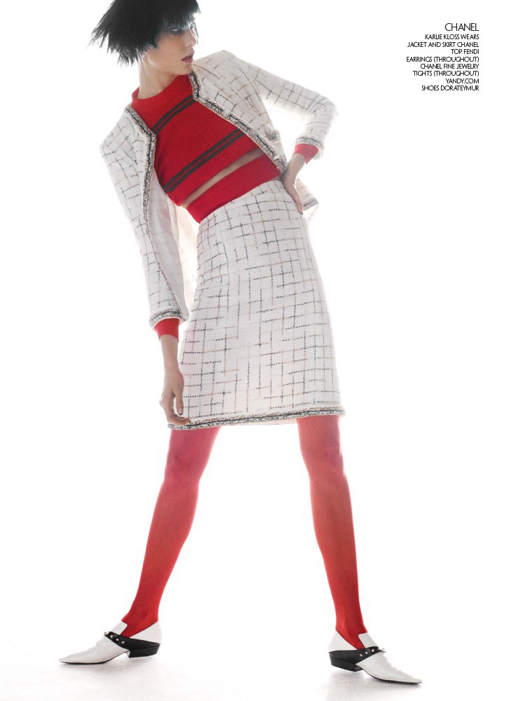 Karlie Kloss models Chanel jacket and skirt with Fendi top and Dorateymur shoes