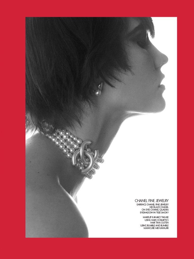 Model Karlie Kloss wears Chanel Fine Jewelry choker necklace and earrings