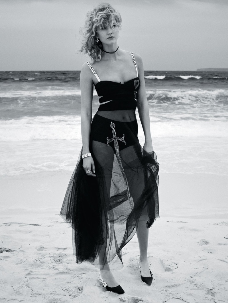 Captured in black and white, Karlie Kloss wears Dior embroidered tulle dress with black knitted bra and heels