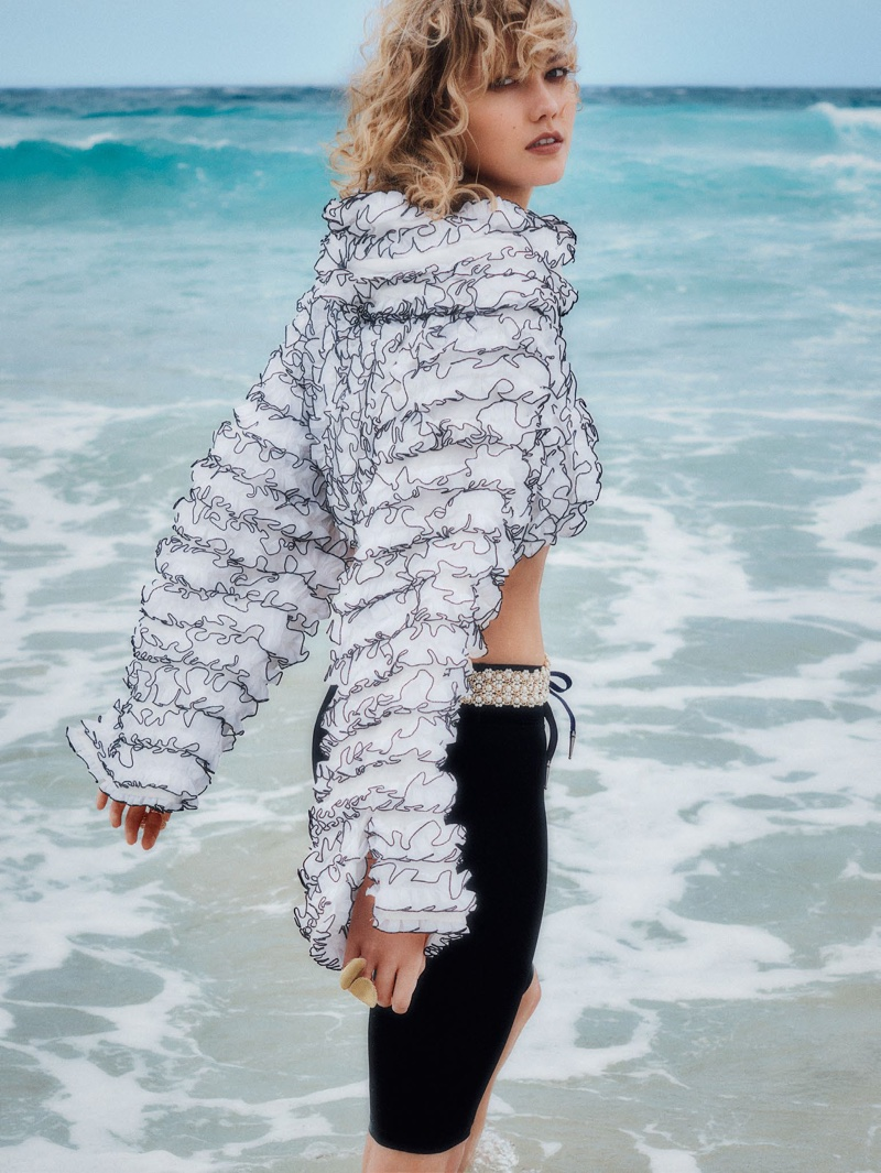Karlie Kloss wears Chanel top and belt with The Upside shorts