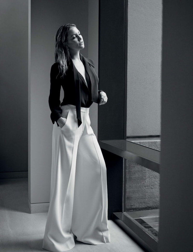 Actress Kate Hudson poses in Michael Kors Collection blouse and wide-leg pants