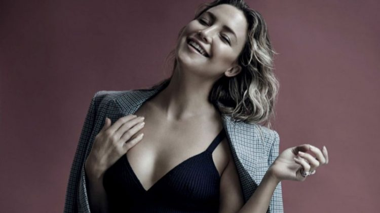 Flashing a smile, Kate Hudson wears Michael Kors Collection wool jacket, knit bralette and knit skirt