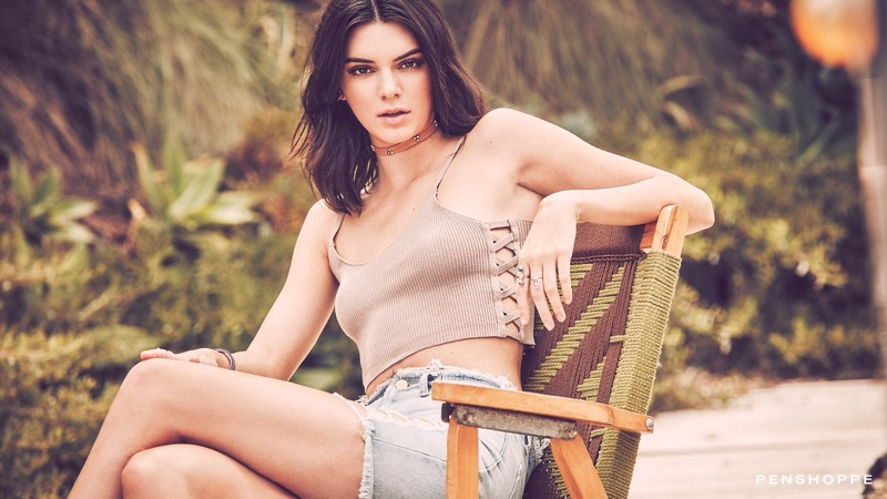 Posing in a crop top with denim shorts, Kendall Jenner fronts Penshoppe campaign