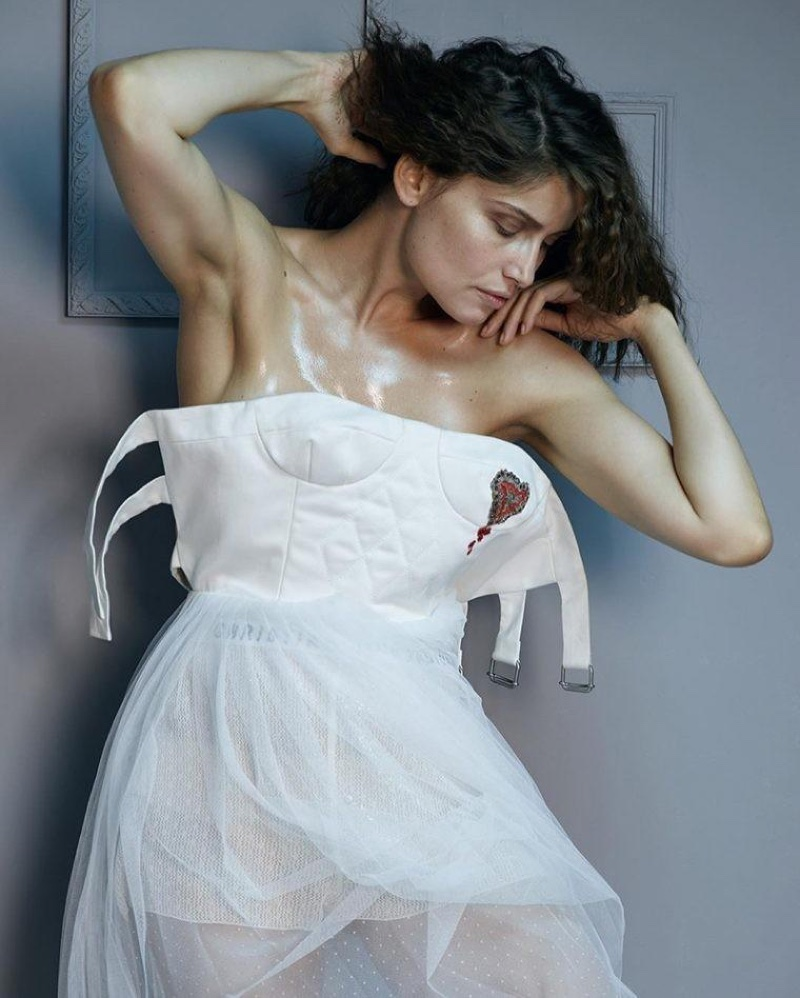 Model and actress Laetitia Casta wears Dior dress with quilted bodice and tulle