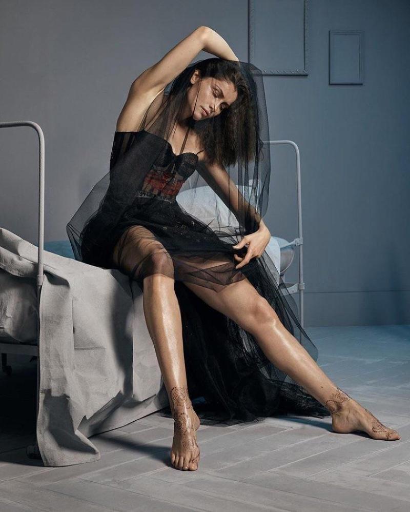 Dressed in black, Laetitia Casta models lingerie inspired Dior dress