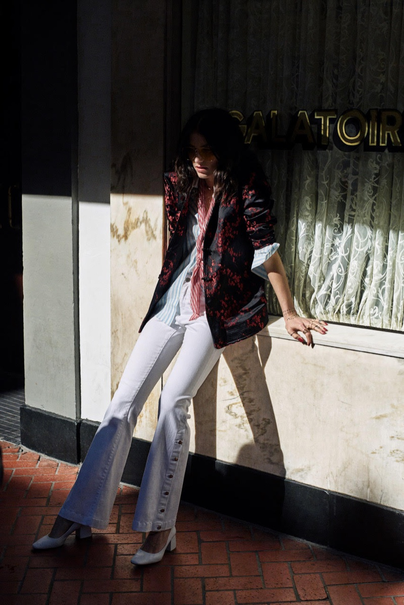 Artist Langley Fox Hemingway wears Mango embroidered jacket and flared denim