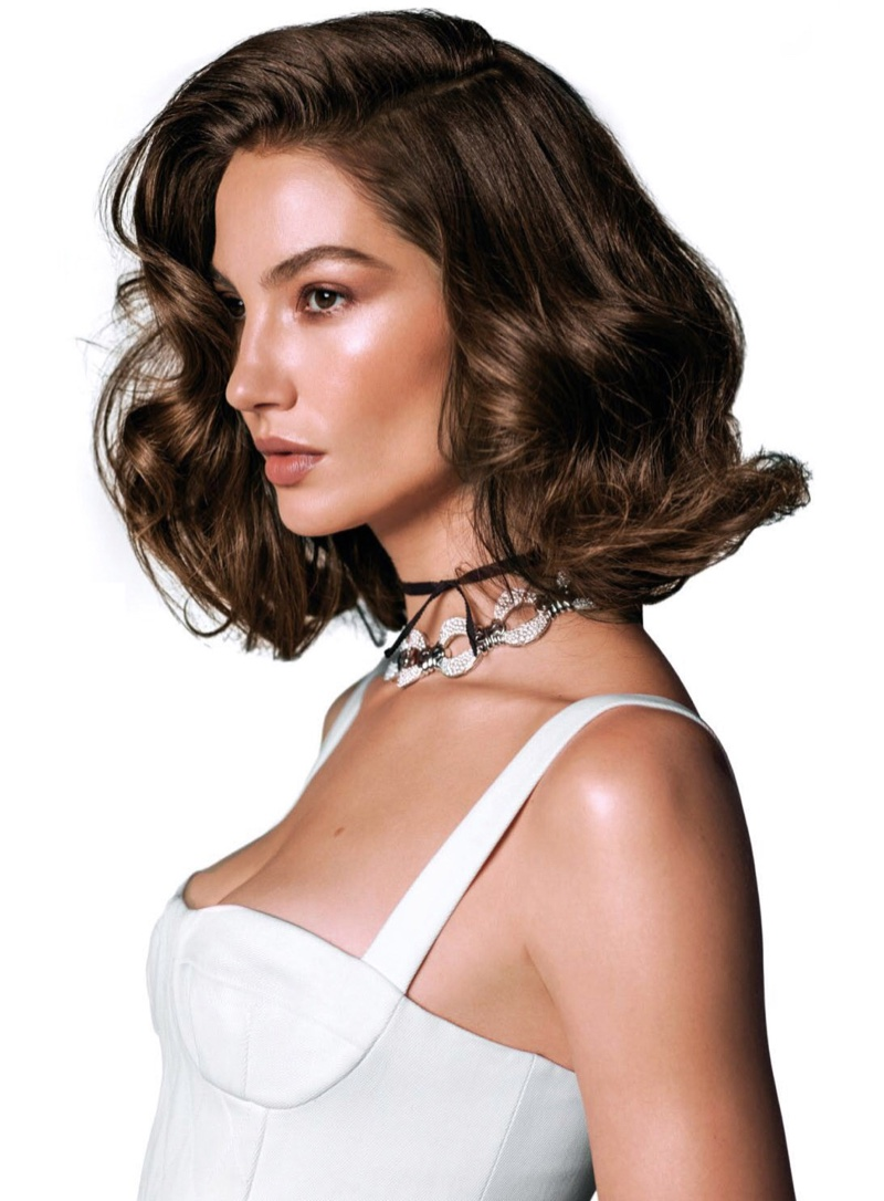 Lily Aldridge models Dior bustier top with Bulgari necklace
