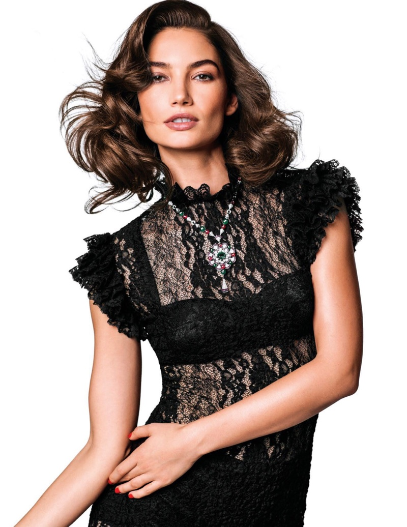 Covered up in lace, Lily Aldridge wears Dolce & Gabbana dress and bralette with Bulgari pendant necklace