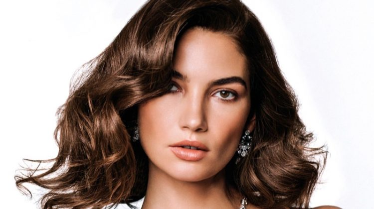 Lily Aldridge poses in feathered top from Prada with Bulgari jewelry