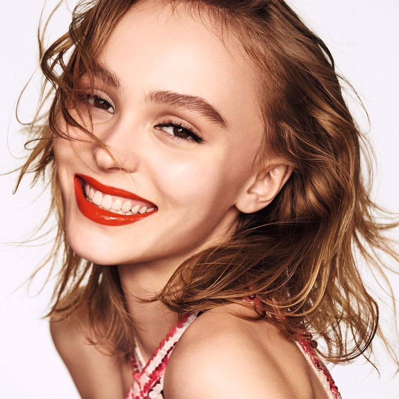 Flashing a smile, Lily-Rose Depp stars in Chanel's Rouge Coco Gloss advertisement