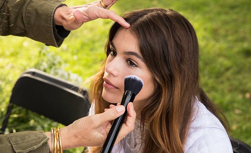 Kaia Gerber gets a touch-up at Marc Jacobs' Daisy fragrance advertising campaign