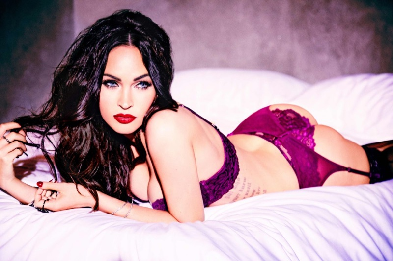 Photographed by Ellen von Unwerth, Megan Fox poses in bed wearing lingerie set from Frederick's of Hollywood