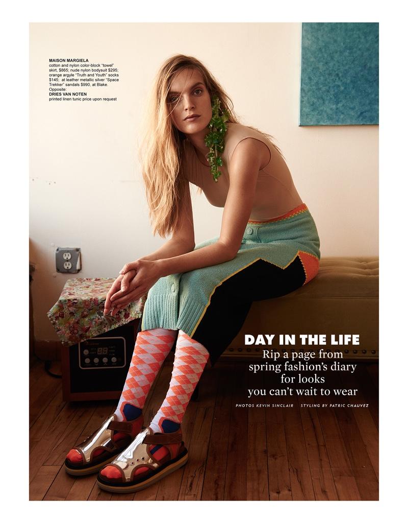 Model Mirte Maas wears Maison Margiela bodysuit, skirt, socks and leather metallic silver sandals