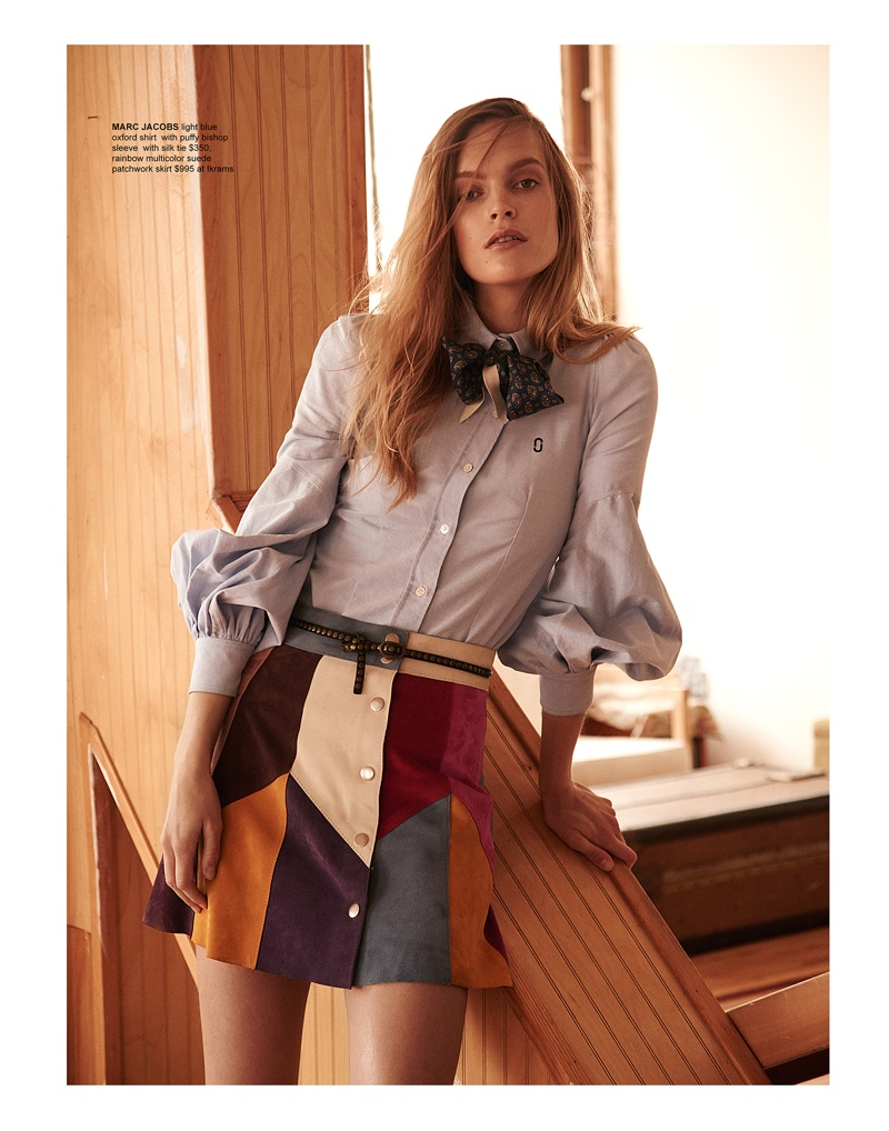 Mirte Maas poses in Marc Jacobs shirt with bishop sleeve, silk tie and patchwork suede skirt