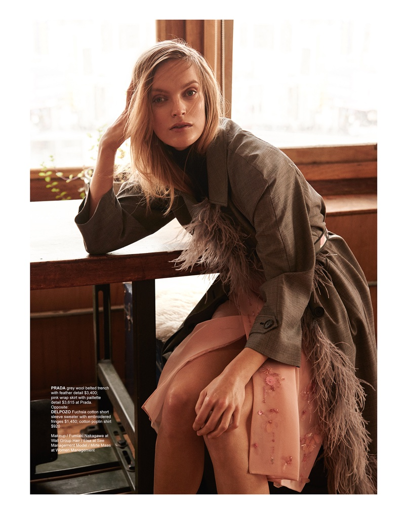 Mirte Maas poses in Prada belted trench coat with pink wrap skirt