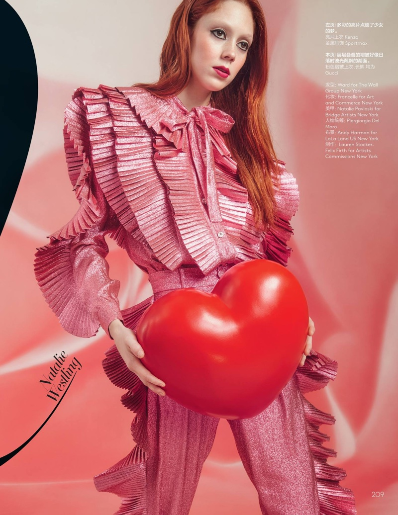 Posing with a heart, Natalie Westling models ruffled top and pants from Gucci