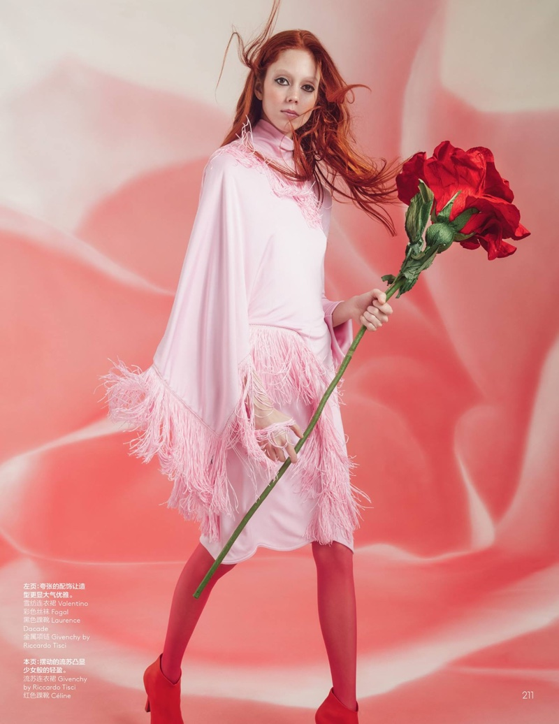 Posing with an oversized rose, Natalie Westling models pink Givenchy fringed dress