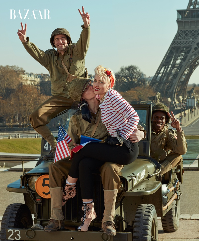 Paris Jackson poses with soldiers in Burberry shirt and pants with Giuseppe Zanotti boots