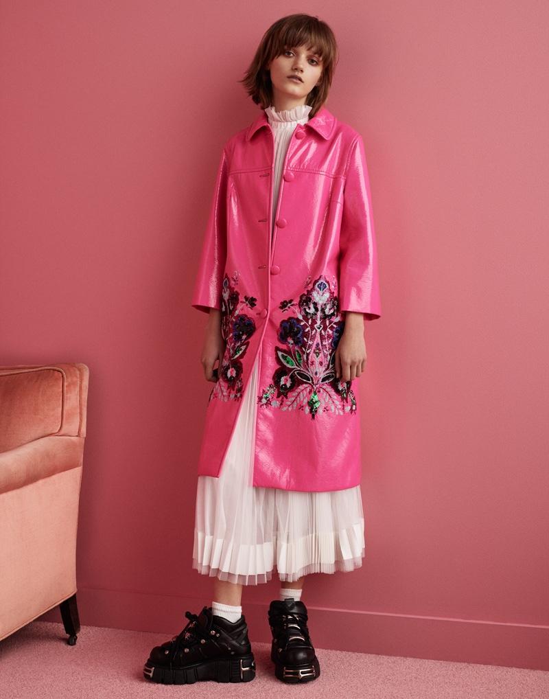 Peyton Knight poses in Adam Selman skirt and blouse with Miu Miu coat