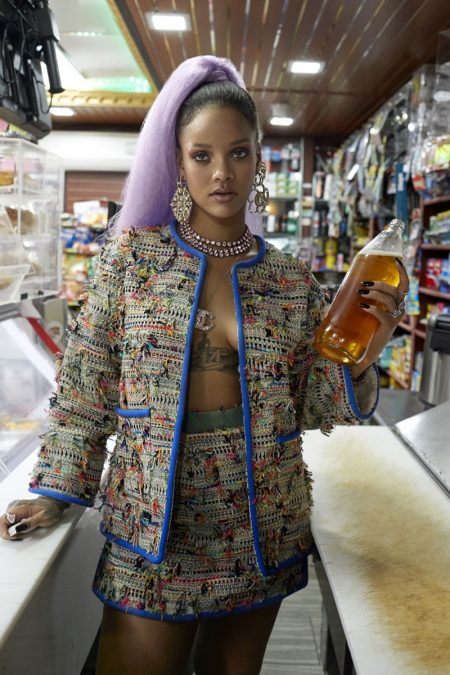 Rihanna wears Chanel jacket and skirt with earrings and pendant necklace by Chanel Fine Jewelry