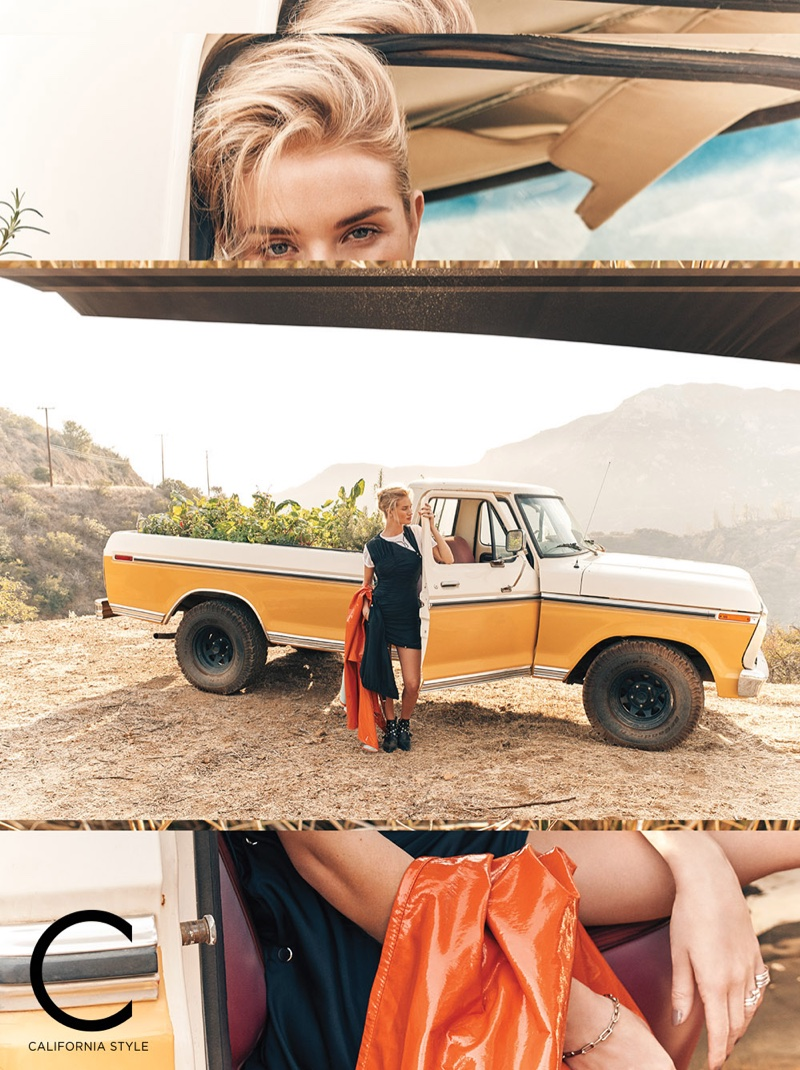 Rosie Huntington-Whiteley poses outdoors in a pickup truck